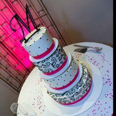 Black & pink wedding cake! Pink uplight background