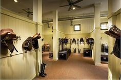 ideal tack room - trunks, saddle racks, stands, bridle hooks, all seperated into sections within one room...plus super classy with ceiling fan and lighting