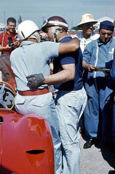 Stirling Moss and Juan Manuel Fangio at Sebring, 1957.