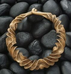 """This is an extraordinary neckpiece (a """"torc"""") from ancient Germany (or possibly Denmark) worn around 600 BC. Made of brass/bronze.  Helen Maciejewski reports on the Facebook page """"Ethnic Jewellery and Adornment"""": """"This is a technique called anticlastic forming that was lost to jewelry makers for a long time. It was re-invented by Finnish metal-smith Heiki Seppa and his student Michael Good is a master of the form."""" (Joost Daalder)"""