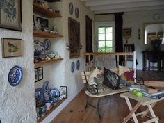 Sitting Room After - Walls lined with organic linen plaster. Pallet wood furniture and recuperated doors and windows