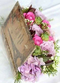 THIS VINTAGE IS BEAUTIFUL--ADDING TO IT'S BEAUTY AN ARRANGEMENT OF ASSORTED BLOSSOMS--