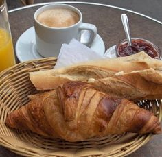 French breakfast - coffee, croissant, baguette, butter and marmalade ... my kind of breakfast.