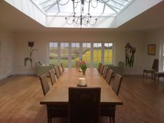 large dinner party, large dining room, wooden floor, massive oak table