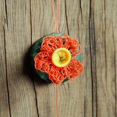 Ballonnetje, gehaakt bloemetje van visserstouw en een dopje