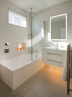 Bathroom Design:  Houzz posted this bathroom because of its creative mood lighting, which is an interesting point.  I'm pinning it because I like the floating vanity that *includes* storage.  Also noting the use of a short section of glass wall to separate the shower from the vanity.