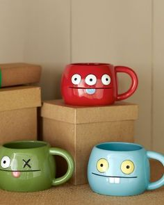 Uglydoll Ox, Babo and Peaco into mugs cups. Really cute! So cool!!