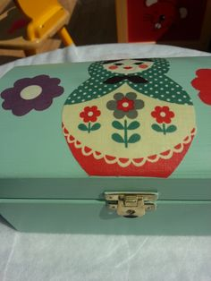 Hand painted vintage style wooden jewellery box. Decoupage effect with russian doll vintage fabric. Finished with varnish.