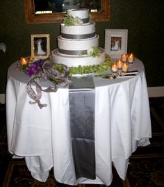 Cake table: Love this idea of putting pictures of our parents on their wedding day.