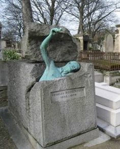 This unique monument shows a young boy jumping upward, out of his grave