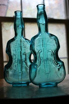 teal blue glass violin fiddle cello bottle pair of viobots with musical notes