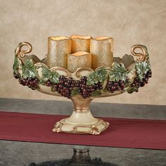 The Vigne Elegante Grapes Decorative Centerpiece Bowl has dark red grapes with sage green leaves on gold vines. Oval bowl has an antique ivory background. Grape Kitchen Decor, Kitchen Centerpiece, Table Centerpieces, Centerpiece Ideas, Tuscan Design, Tuscan Style, Mason Jars, Vides, Wine Night