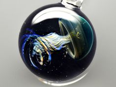SPACE GLASS: PLANETS AND GALAXIES at bay IN small GLASS PENDANTS BY JAPANESE creative person. Being a proficient glass creative person in Japan.....