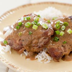 Filipino Chicken Adobo    ---  8 (5- to 7- ounce) bone-in chicken thighs,    trimmed      1/3cup soy sauce      1(13 1/2-ounce) can coconut milk      3/4cup cider vinegar      8 garlic cloves, peeled      4 bay leaves      2 teaspoons pepper      1 scallion, sliced thin