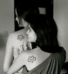 sister tattoos. looks like the polyamory infinite love symbol