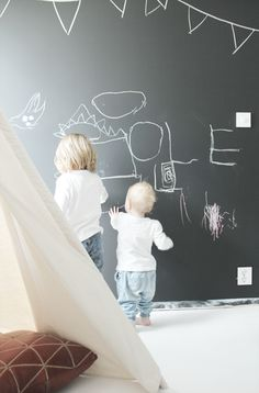 Love this wall... Kids can occupy themselves while being expressive in their own rooms
