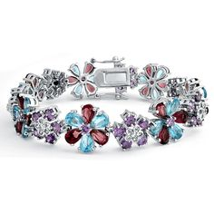 Our CZ teardrop amethyst and aquamarine color bracelet is made of beautiful aquamarine and amethyst color teardrop cubic zirconias that form dazzling flowers. This incredible amethyst and aquamarine color bracelet secures with a box clasp with double safety wings. Rhodium plating gives this floral aquamarine and amethyst color bracelet the look of platinum while resisting tarnish.