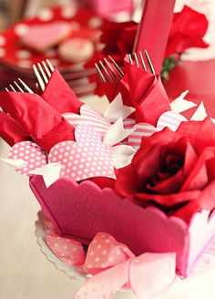 Great spin on the Martha Stewart Peppermint Place Cards, turn them into hearts w/ arrows for napkin rings #valentine #party #cupid