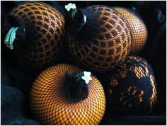 Interesting idea- covering pumpkins with designed fishnet stockings. I kind of dig the look.