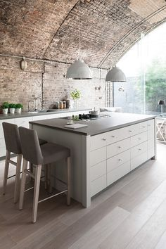 The Limehouse kitchen finished in Lily Eggshell with grey Ceramic tops.