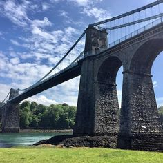 30 January 1826. The Menai Bridge the worlds first modern suspension bridge designed by Thomas Telford opened. #menaibridge #anglesey #engineering Bridge Design, Anglesey, Suspension Bridge, Brooklyn Bridge, First World, January, Engineering, Modern, Travel