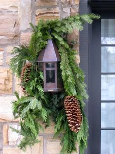 Pinecones and evergreen garland. I might be doing this on our lights beside the garage, maybe the front door too!