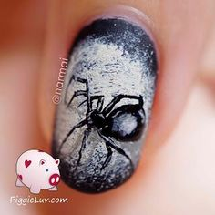 This spider was an unexpected nail win, I hadn't expected it to turn out okay but it did :) I did (nail fail) spiderwebs nail art last year for Halloween, and I figured it was worth another try!