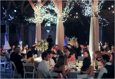 Lighting changes the mood and setting of a wedding reception in the Fearrington Barn