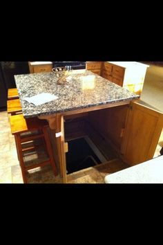 storm shelter/panic room/secret hid out in the kitchen island! Best secret passage ever! Definitely a dream home feature! (would also be good if someone broke into your house and you had to hide somewhere)QUARTO SECRETO. Home Design, Secret Passage, Diy Home Security, Security Room, Security Safe, Sweet Home, Home Defense, Design Case, My Dream Home