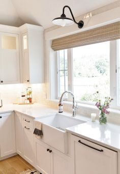 To create a casual farmhouse kitchen decor, a gooseneck light coordinates with quartz counter tops, farm sink, and shaker cabinets! Learn more about this 1890 farmhouse renovation! Kitchen Sink Window, Farmhouse Sink Kitchen, Modern Farmhouse Kitchens, Home Decor Kitchen, New Kitchen, Home Kitchens, Kitchen Design, Farmhouse Decor, Kitchen Sink Lighting
