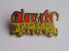 grateful dead hat pins | ... Melt pin in orange - Phish inspired collectable badge lapel hat pins