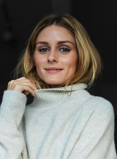 Who made  Olivia Palermo's tan turtleneck sweater?