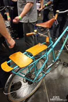 The rear rack on this Joseph Ahearne cargo bike has a rotatable section that can serve as either a solid shelf or a seat for kids.