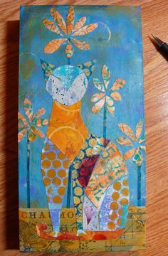 Diane Salter - A New Step-by-Step Tutorial for 2015 including the use of Gelli painted papers!  So  next--assembling  this  'puzzle'  on  my  cradle  board--  my  kitty  with  some  daisies  I  just  use  regular  gel  medium  to  adhere  all  of  these  pieces.  next  step--the  fun  part--