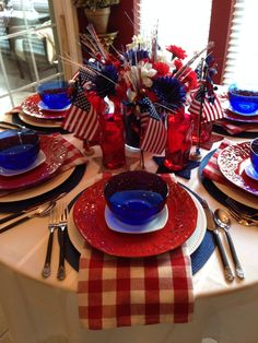 2014 4th of July tablescape for the kitchen. I think the favors, the flag and pinwheel, looks great in front of the plates. They can easily be used as place card holders as well. Picture 1 of 2.