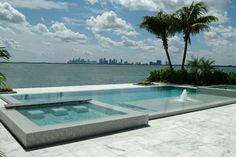 Overlooking the Miami skyline, this award-winning geometric, glass tile pool and spa combination includes a tanning shelf and custom-crafted in-spa seating. Essig Pools, Inc., North Miami, Florida (2012 Aquatech® Awards) http://www.poolspaoutdoor.com/photos/2012-aquatech-award-winning-pools.aspx