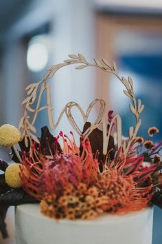 Gold monogrammed wedding cake topper with fall flowers   NICOLA
