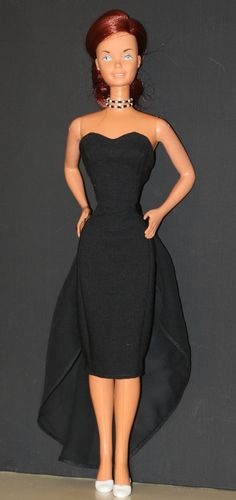 Custom dress for a Super Size Barbie. Simple black princess seam, sweetheart neckline, sleeveless cocktail dress with detachable sheer train.   SOLD