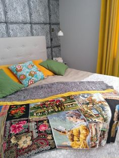 Bedroom bohemian style. Blanket decorated with old embroidery.
