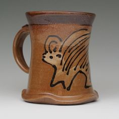 Mug with porcupine stoneware pottery. via Etsy.