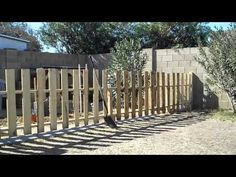 landscape with pallets | How to build a fence using pallet wood - Cheap, simple & easy ...