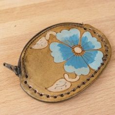 The perfect spot to carry coins, jewelry, or other small things the Belle Leather Coin Purse has a beautiful turquoise wild rose on it.