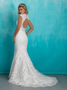 This Allure Bridal design features a lace-edged keyhole back and dazzling scalloped beadwork ensure this sheath is beautiful at every angle. Available in White/Silver, Ivory/Silver, Cafe/Ivory/Silver. Available now at Weddings with Joy.