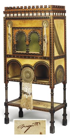 CARLO BUGATTI (1856-1940)  cabinet, circa 1902,  walnut, bone applications, hand-painted vellum, copper, mahogany and pewter inlays, silk tassels, the door with glazed panels, 60 in. (152 cm.) high., 28 5/8 in. (72.7 cm.) wide., 14½ in. (36.9 cm.) deep, hand-painted signature Bugatti   |  SOLD $34,830 Christie's London, Oct. 28, 2008