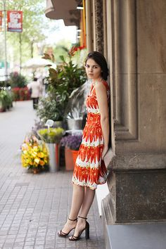 love the color orange and dresses!