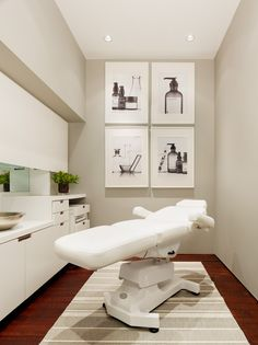 Facial room. Simple clean. Love it. Classic, dark floors. Cool white walls. Add a chandelier for elegance.