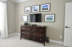 gallery wall around wall mounted TV