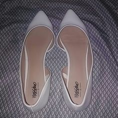 White pointed toe flats Really cute and unique pair of shoes. A few barely noticeable scratches and marks that Can be fixed easily. These shoes are stylish and comfortable. Get spring ready ladies!!!! Remember I am always willing to take offers unless stated otherwise Shoes Flats & Loafers