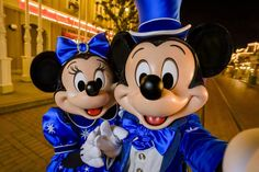 Mickey & Minnie Mouse selfie in their 25th anniversary outfits on Main Street USA in Disneyland Paris