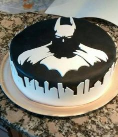 This is pretty awesome. I focused on the black frosting at first, thought that was meant to look like black blood running down the sides of the cake (and maybe it is) but look at the white. It's actually the Gotham skyline.